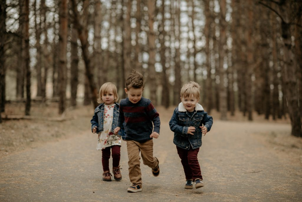 Kids running at Birds Hill park during a family photo session