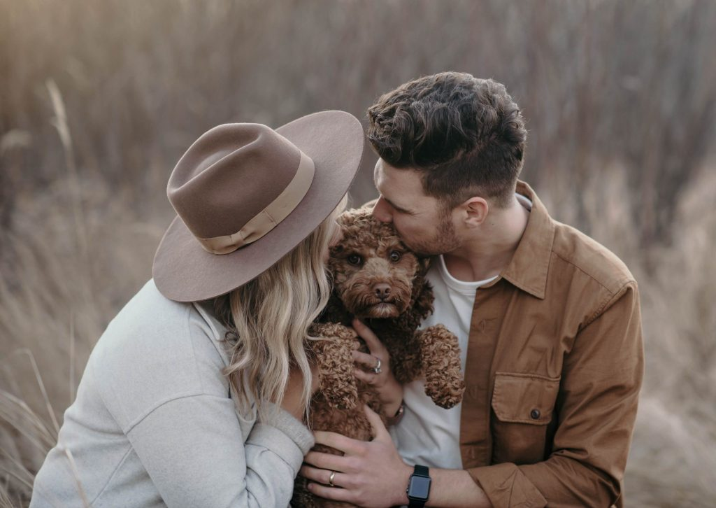 Couple Kissing Dog during a couple photo shoot